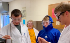 Juniors Gunner Kirchhoff, Molly McFadden, Drey Newell, and Skyler Handlos preform an experiment. The students were assigned to create a video explaining different reactions.