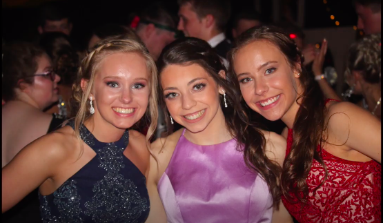 Three seniors pose for a picture at last years prom. Prom 2020 is themed The Roaring 20s.