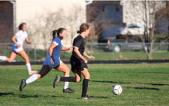 Senior Kenzie Waters dribbles the ball down the field during a game last year. Waters participated in the Quarantine Cup.