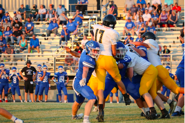 Colten Tasto catches some air at Friday night's game. The Trojans kicked off the season in Underwood.
