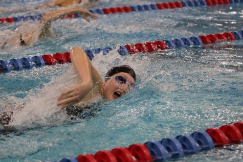 Junior Alexis Reynolds swims in a relay at last year's state competition. The girls placed 17th at state.