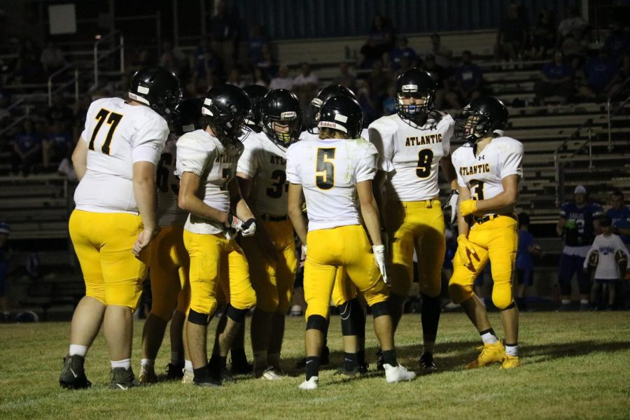 The Trojans huddle in during the game against Underwood to devise a plan. The boys will play the Cardinals in Glenwood on Sept. 18.