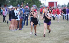 Freshman Faith Altman rushes towards the finish line at DCG. Altman placed 46 with a time of 25:00.9 in Pella.