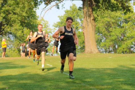 Senior Ethan Williams races to the finish line. Williams is one of seven varsity runners on the boys team.