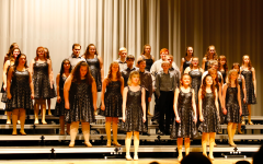 The 2019 freshman show choir performs on stage. The days of performing in close groups have been put on hold due to the pandemic.