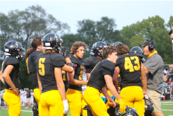 The Trojans huddle up while preparing for the next play.  The Trojans are currently 3-1.  Grant Sturm had four receptions last Friday night.