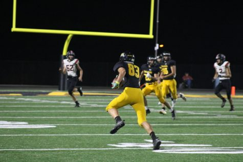 Sophomore Jayden Proehl runs the ball. This was the Trojans