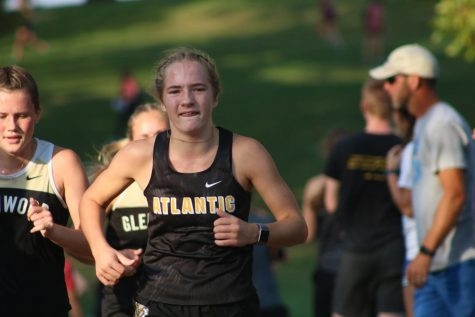 Freshman Claire Pellett runs hard at a meet earlier this season. Pellett has run varsity all season.