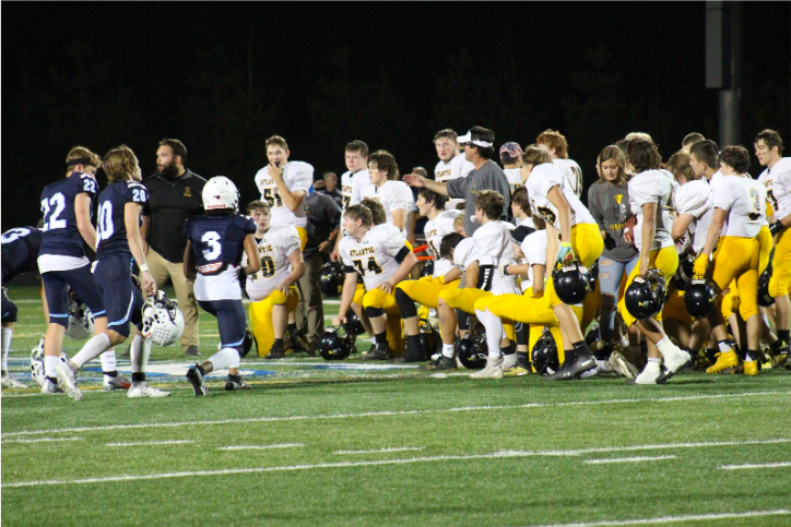 TheTrojans say a word of prayer after the Des Moines Christian game. They won the game 38-0.