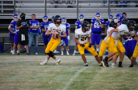 Sophomore Caden Anderson gets ready to throw a pass downfield against Underwood.