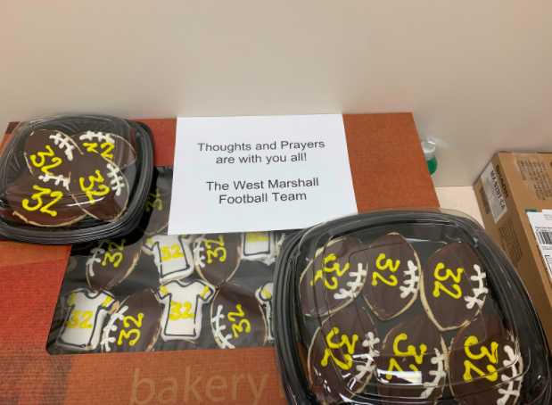 The West Marshall football team sends football and jersey-shaped cookies to Atlantic High School in support of Steele McLaren. The Trojans are heading to West Marshall after qualifying for State.