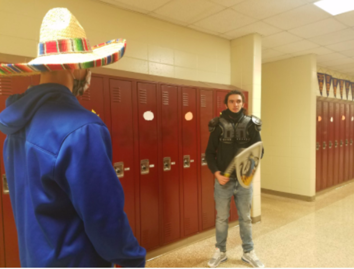 Spanish 4 students Craig Alan Becker and Colin Mullinex act out a scene from the book Don Quijote. Students read Don Quijote in Spanish, translate it to English, and then recreate parts of the book.