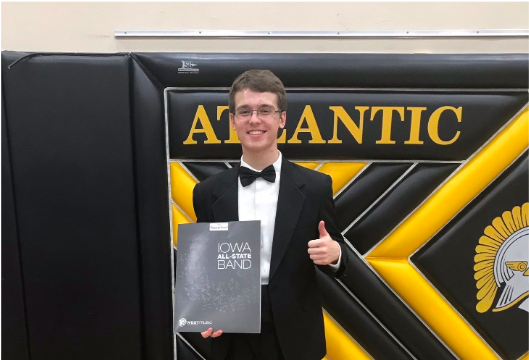 Lex Somers celebrates acceptance into the all-state band during his sophomore year. All four years of high school, Somers auditioned and earned a spot in the band.