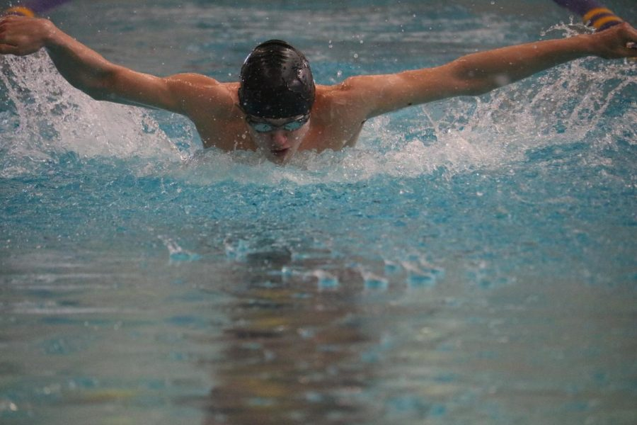 Junior Brayden Atkinson swims at a Johnston meet from the previous year. At the latest competition in Carroll, he brought home a 1st place win in the 200-yd IM.