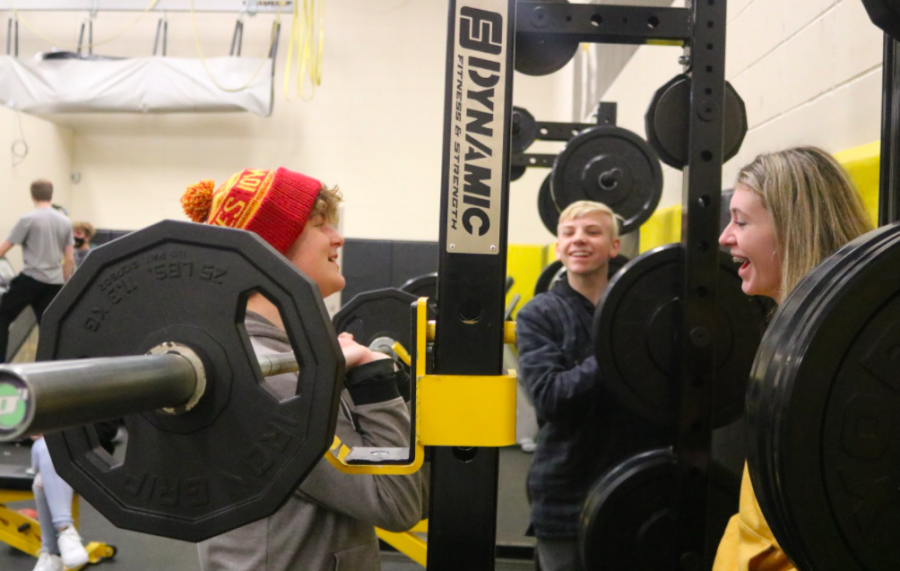 LIFTING AND LAUGHING - Aiden Petersen, Jade Harter and Tate Niklasen share a chuckle while lifting. Most AHS students enjoy the environment of the class. Most of the time there is music playing loudly in the weight room.