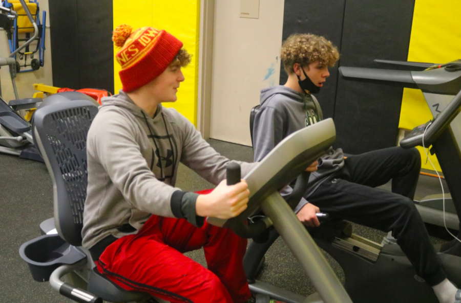 SPIN TWINS - Aiden Petersen and Nolan Waters put some miles on the exercise bikes. Students were given the option to do cardio instead of lifts. These freshmen took the opportunity to use the machines.