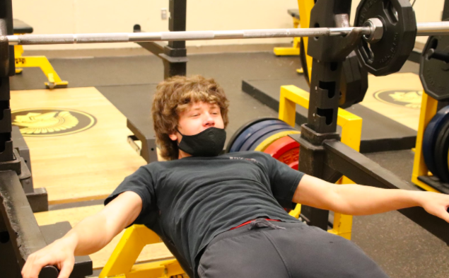 THE GRIND IS ON - Sophomore Tanner O'Brien lifts almost every morning for wrestling.  However, he still lifts during the school day as well. O'Brien's favorite lift is bench press, and he has reached a 205 max for one rep.