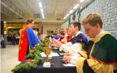 The seniors from last year's madrigal sit at the head table for the Middle-ages themed dinner and performance. There will be a few changes to the holiday concert this year to accommodate to COVID guidelines.