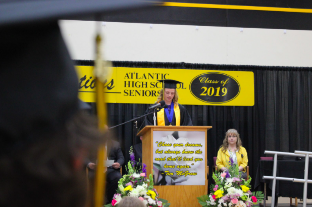 The Class of 2019 adorn themselves in black and gold as they take to the stage for their graduation ceremony. The flowers consisted of perennials.