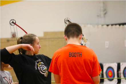 Halle Copeland shoots at a home tournament from last year. Copeland said take into consideration stance, form, and where to aim before shooting an arrow.