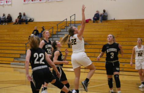 Senior Maycie Waters (22) goes up for the shot.  The Trojans lost 68-52 against Glenwood.  Waters ended the game with 10 points.