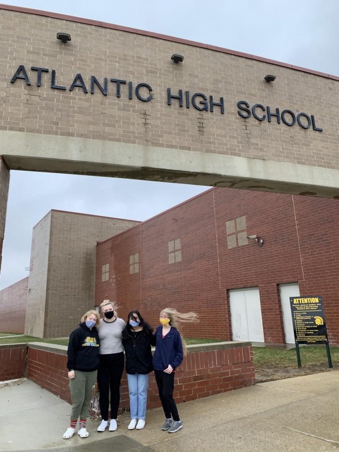 AHSNeedle Senior Staff stand under the high school's sign. We feel the school hasn't included our class in enough conversations and decisions this year.