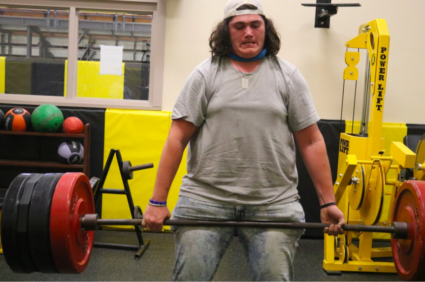 HARD WORK PAYS OFF - Senior Zach Colton deadlifts and works hard to get to his max. Colton played football all four years of high school. Lifting was a big part of gaining muscle for the season.