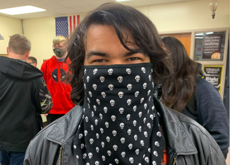 """Alas, poor Yorick!"" While students do not have the choice to mask or not to mask, they can make a style statement. Senior Steven Ballard wears a skull-themed bandana mask. Some students use masks to make a fashion statement."