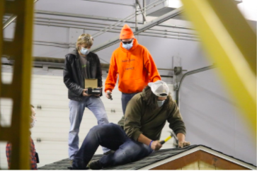 Seniors Devin Wood, Noah VandeVanter, and Zach Colton help build on the roof. The class is only open to juniors and seniors with the correct prerequisites and takes place over two class periods. It is held at the Achievement Center.