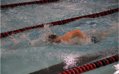 Junior Bryan York swims in his lane against other opponents in the home meet. York received first place in the 100-yard freestyle swim.