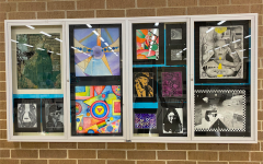 Students' art work is shown in a display case located in the commons. There are currently 40 students involved in different levels of art class.