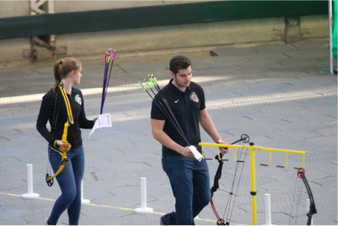 Sophomore Dayna Dreager and senior Joseph Sonntag prepare to shoot at State Archery last year. Both Sonngtag and Dreager think the team is doing well this season, and they hope to continue improving.
