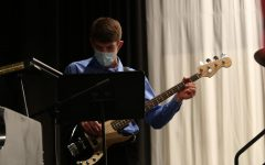 Senior Ethan Williams focuses on his music as he play bass at Swing Inn. Williams is also involved in cross country, basketball, tennis, musical pit, and marching and concert band.