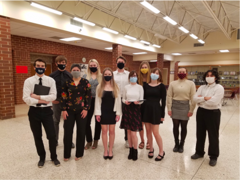 Students who participated in the reader's theatre for speech stand for a picture. The group received straight ones at state on Saturday.