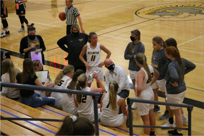 Encountering new regulations, the girls basketball team stayed masked as often as they could. The girls were able to play all of their games this season despite COVID.