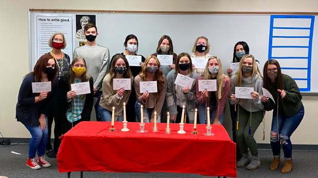 Quill and Scroll Inductees received a certificate and a pin after lighting their candles during the ceremony. Seniors also received a blue and gold cord for graduation.
