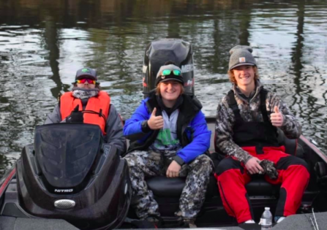 Seniors Brendan Atkinson, Drey Newell, and Braden Smith smile on the pond. The boys have placed second in two tournaments.