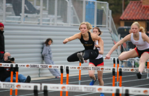Senior Caroline Pellett keeps her eyes on the finish during the 100m hurdles. Pellett has been in track, among other activities, throughout her high school career and will be playing softball at Simpson College next year.