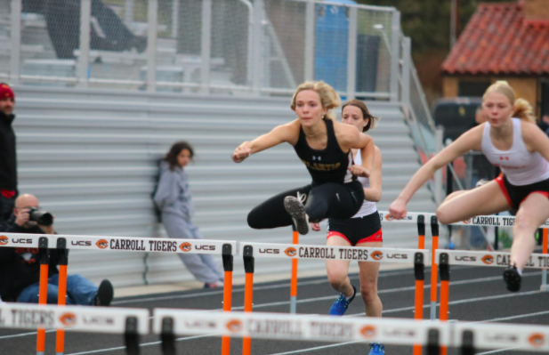 Senior+Caroline+Pellett+keeps+her+eyes+on+the+finish+during+the+100m+hurdles.+Pellett+has+been+in+track%2C+among+other+activities%2C+throughout+her+high+school+career+and+will+be+playing+softball+at+Simpson+College+next+year.