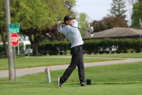 Junior Lane Nelson preps for a swing at a home match. At the Hawkeye Ten Championship, Nelson placed 7th individually with a score of 80.