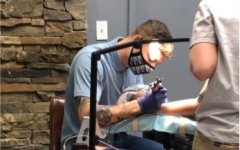 """Former AHS student Harison  Richter, who graduated in 2015, now tattoos professionally. He began working the front counter at Big Brain West in September of 2020 and has been an apprentice since November of 2020. Only in """"the last month or so"""" has he been tattooing people."""