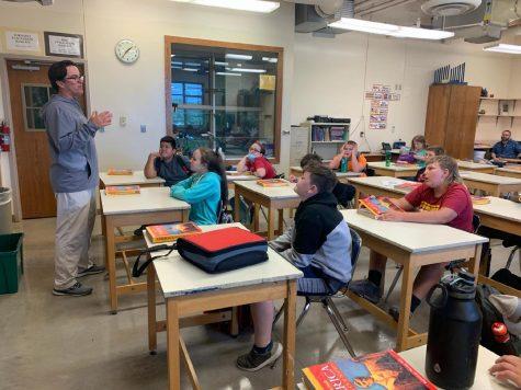 Eighth grade teacher, Mike McDermott, teaches his class in the high school art room.