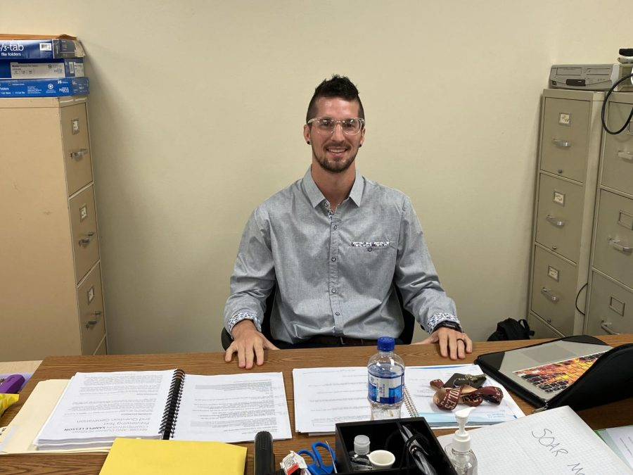 Jesse McCann waits at his desk eager to teach his new students.