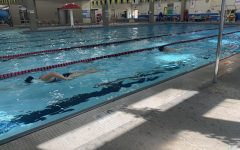 The girls swim team practices for their first meet.