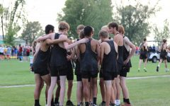 The cross country team comes together to support each other.
