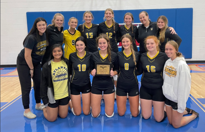 The volleyball team celebrates their win at the AHSTW tournament.