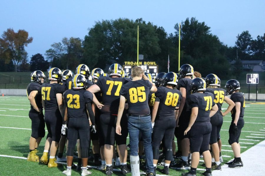 WHATS THE PLAN?- The football team crowds together to discuss plays and to have spirit right before the game starts.