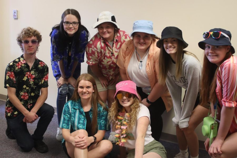 TACKY TOURIST- Ms. Wallaces class poses for a picture in bucket hats, Hawaiian shirts, and flower necklaces.