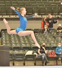 Nicole Middents has been competing in gymnastics since she was young.